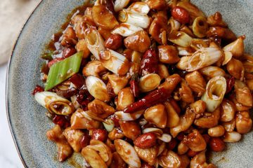 Kung Pao Chicken (宫保鸡丁) in Chinese is a stir-fried dish with chicken cubes, dried chili pepper and deep-fried peanuts. The tender taste of the chicken matches great with the crispy peanuts with a combined sweet, sour and spicy taste. Background of the dish The name of Kung Pao comes from…