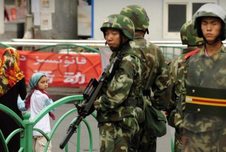 China fiercely defends Xinjiang camps after denying they exist